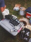 Sampling set up showing meters for dissolved oxygen, pH, redox, and electrical conductivity, bottle capper and other supplies.