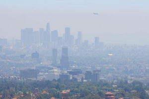Photograph of smog above an urban landscape.